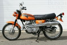 Honda CL175:  My first bike.... this exact color, model and year.  I put 10,000 miles on it that first summer.  I loved motorcycling.