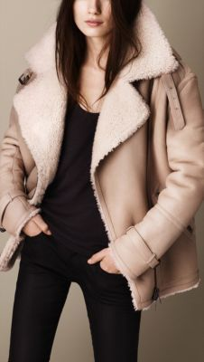 An oversize aviator jacket in sueded shearling. The unlined design has a soft nubuck outer and shearling fur interior with contrast turnback collar and cuffs. Angled pockets are finished with graphic detail, while zip cuffs feature buckled cuff belts, inspired by heritage designs.