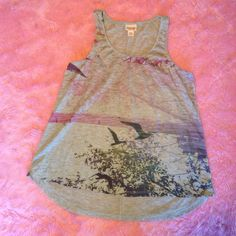 ✨High Low Racerback Tank Cute hi-lo flowy Racerback tank top. Gray with purple and green graphic of bird silhouettes flying through the trees. Never worn. Perfect for spring and summer! Size medium. ✨Item valid for BOGO 50% off deal! Ask me about it! Mossimo Supply Co Tops Tank Tops