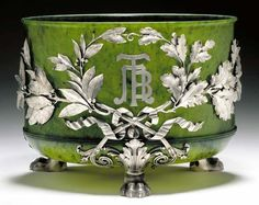"""A RARE NEPHRITE AND SILVER-MOUNTED PRESENTATION BOWL  marked Fabergé and with the workmaster's mark of Julius Rappoport, St. Petersburg, circa 1890 On three cast and chased silver paw feet, the circular body mounted with a silver laurel and oak leaf wreath enclosing the inlaid silver interlaced Cyrillic intials PTB and the inscription """"XXV"""" and the date """"XVII au[gust] MDCCCXC y[ear]"""", fully marked"""