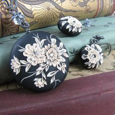 Laurabee Studio: black & cream polymer clay earrings made using the appliqué technique (sometimes known as the embroidery technique).