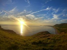 Beautiful sunset views over Rhossili Bay in Gower, near our Gower Cottages! Rhossili Bay, Gower Peninsula, Weekend Breaks, Paddle Boarding, Beautiful Sunset, Outdoor Activities, Cottages, Wales, Surfing