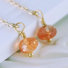 Gold threader earrings with sparkly sunstone gems.