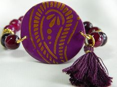 Stretch bracelet round circle fuschia polymer charm and purple agate beads and tassel