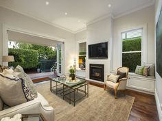 Maybe our northern wall should have windows around a central fireplace/TV hub??? Like the bench seats with storage. 17 Empress Road, Surrey Hills, Vic 3127