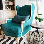 living rooms - turquoise blue french wingback chair turquoise blue pillow white espresso brown chevron rustic stool table built-ins cabinets shelves living room West Elm Zigzag Rug