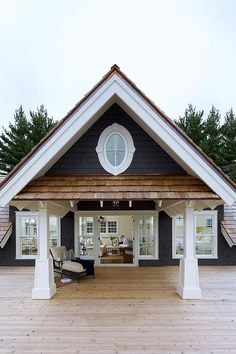 Pretty sure this will be the color of our home. Blue siding. White trim. Medium brown shingles. Natural wood brown flooring and deck.