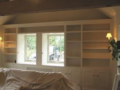 Fitting a whole wall out can create a vast amount storage while at the same not enclosing a room. Fitted Cabinets, Bookcase, Furniture Design, Shelves, Storage, Create, Wall, Room, Ideas