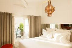 A neutral bedroom with gold chandelier