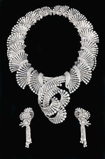 A Boucheron diamond set from 1947, necklace convertible into a Tiara and matching brooches #christiesjewels #boucheron