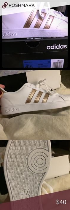 Brand new Adidas shoes Brand new Adidas Baseline K women's 4.5 shoes. White with gold accents. Too big for daughter. Comes with box! adidas Shoes Sneakers