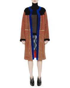 Honeycomb-Cutout Coat with Shearling, Long-Sleeve Rib-Knit Optical Sweater & Jacquard Lace Pleat Wave Miniskirt $2495 by Marco de Vincenzo at Bergdorf Goodman.
