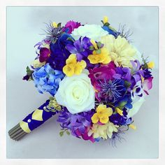 Realistic, silk/artificial, bridesmaid bouquet created by Something Floral, Warren, MI, for a wedding in Evansville, IN. #blue #wedding #bridesmaid #bouquet. Photo from Instagram by somethingfloral