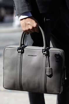 Get a handle on Burberry's luxurious leather goods, like this versatile briefcase.