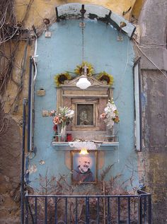 street shrine, Naples (Madonna above, Padre Pio below), via Flickr.