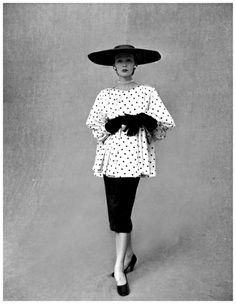 Sophie Malgat in polka dotted smock top over black skirt by Balenciaga, Paris, February 1951