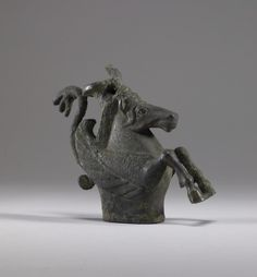 Pegasos Ornament from a Chariot.  Culture: Greek  Place of origin: Greece  Date: early 5th century B.C.  Period: Archaic  Medium: Bronze-The Ancient Way of Life