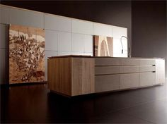 Wooden kitchen from Toncelli with island and MGS Vela LD black PVD stainless steel kitchen tap
