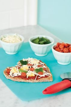 Sweetheart Pizzas Use a heart-shaped cookie cutter to cut prebaked whole-wheat pizza crusts. Top crusts with tomato sauce, shredded mozzarella cheese and toppings of your choice (we used a mini—heart-shaped cookie cutter to make ours extra special). Bake pizzas at 450°F for 8 to 10 minutes, or until cheese is melted and bubbly.