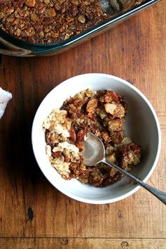 Baked Steel Cut Oatmeal // When it bakes, the mixture separates into distinct layers, the nuts forming a crisp-like topping, the berries bobbing underneath, the creamy oats and custard forming the foundation. The steel cut oats, flavored with cinnamon and maple, remain firm and chewy, which along with the nuts offer the loveliest texture throughout. // @alexandracooks