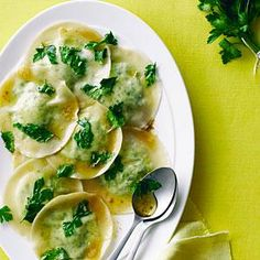 Won ton wrappers make a great substitute for homemade pasta, so you can whip up these tasty ravioli on a weeknight. They're made with flat-leaf parsley, also called Italian parsley, which tastes much more robust than the curly variety. Parsley is a great source of vitamins A, C, and K, so use it generously, as this recipe does.