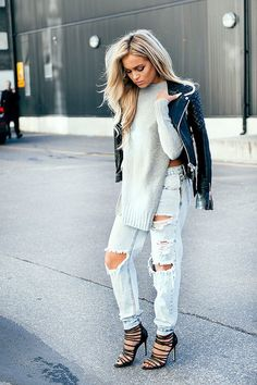 Something as simple as opting for a black quilted leather biker jacket and light blue destroyed boyfriend jeans can potentially set you apart from the crowd. Why not introduce black leather heeled sandals to the mix for an added touch of style?   Shop this look on Lookastic: https://lookastic.com/women/looks/black-biker-jacket-grey-tunic-light-blue-boyfriend-jeans/17885   — Black Quilted Leather Biker Jacket  — Grey Knit Tunic  — Light Blue Ripped Boyfriend Jeans  — Black Leather Heeled…
