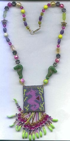 Seahorse amulet bag. Larger beads are new Czech glass, vintage German glass and Venetian foil lined lampwork beads.