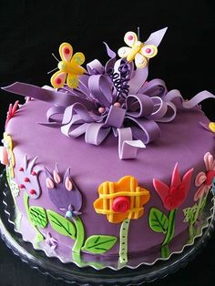 Pretty flowers and butterflies purple cake