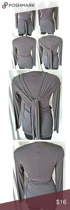 """Lilac Maternity Gray Knit Top Lilac Maternity Gray Knit Top Cross Front with Very Long Tie  Made in the USA by Lilac Maternity Size Large Soft comfortable fabric Long wrap tie that can probably be worn in a number of creative ways Wrap tunic is quite stretchy Gathers at the side 95% Rayon, 5% spandex Hand wash, dry flat  Measurements are approximate:      Length 31""""     Sleeve 24""""     Chest 30"""" - 36"""" stretched     Waist 26"""" - 32"""" stretched     Hips 32"""" - 38"""" stretched Lilac Clothing Tops"""