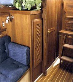 The hanging locker is located by the companionway. Vented louvered door helps prevent mildew. [Image from the original Pacific Seacraft brochure]