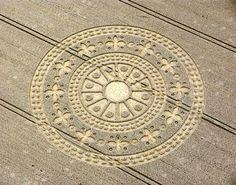 Crop Circle resembling a rug emblem, or perhaps a medieval church window.