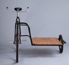 the 'sidecar bicycle' by horse is a stout three wheeler with a hardwood flatbed and small 12 inch wheel.