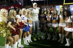 Houston Texans' J.J. Watt poses with the Pro Bowl cheerleaders after Team Irvin defeated Team Carter 32-28 in the NFL Football Pro Bowl Sunday, Jan. 25, 2015, in Glendale, Ariz. (AP Photo/Mark Humphrey)