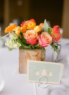 Coral blooms in wood vases #coral #centerpiece #wedding #roses