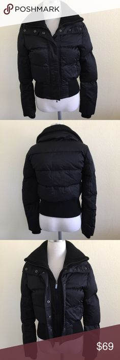 Theory Black Down Puffer Bomber Jacket, XS (P/TP) Theory Black Down Puffer Bomber Jacket in size XS, Theory size P/TP. Flat lay measure from shoulder to hem is approximately 20, and from armpit to armpit is approximately 18.5. Features a Down filling for extra warmth and comfort, zipper and snap closure and stretchy waistband. She'll is made from55% cotton and 45% nylon, lining is 100% nylon and filling is 80% grey duck down and 20% feather. In excellent condition, please look at all photos…
