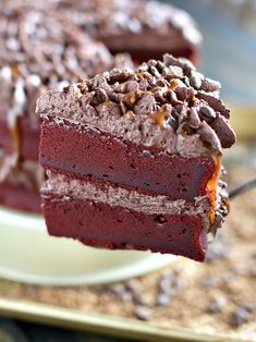 Chocolate Coffee Cake with beautiful red velvet, coffee infused, brownie layers covered in a delicious chocolate buttercream and caramel drizzle.