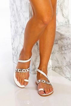 Classic with a twist, Eve sandals featuring our signature chain strap with a plain toe ring and ankle wrap. Handmade of the best quality white with silver details leather, these unique sandals are the type you can wear instead of heels without feeling under-dressed. A great choice for elegant, modern and boho Bride. Greek Chic Handmades sandals are handcrafted in Athens and designed to accompany you everywhere. From the city to beach escapades and resort evenings.
