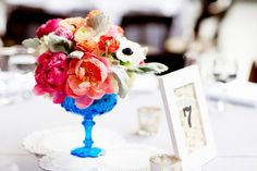 Coral charm arrangement in vintage blue compote by Fleur, photo by Olivia Leigh