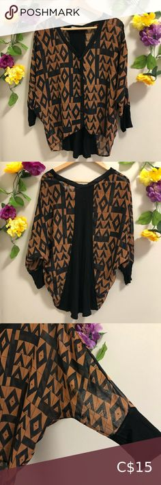 4/$20☀️ Lush Sheer Blouse - Geometric Design This item is part of the 4/$20☀️ sale Lush Sheer Blouse - Geometric Design The patterned parts are sheer & the black cuffs & back are like t-shirt / jersey fabric There is no size in it, it's meant to be worn oversized & the pit to pit is approx 26 inches & the bottom is 21 inches wide so I'd estimate a medium but please check before purchasing It's in good worn condition, a few tiny pulls but hard to notice & some stitching has come away slightly at  Layering Tank Tops, Orange Blouse, Off Shoulder Sweater, Red Tank Tops, How To Roll Sleeves, Sheer Blouse, Lush, Stitching, Cuffs