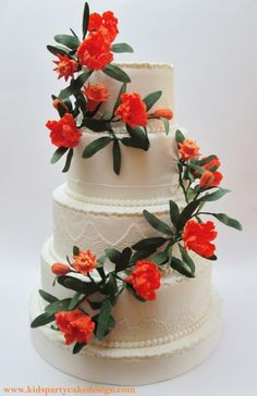 Maria Teresa was inspired by the beautiful flowers of the pomegranate. Every year when this tree blooms enchants me with his bright orange flower. for this reason I decided to recreate these flowers on a wedding cake, I love the contrast of the pure white of...