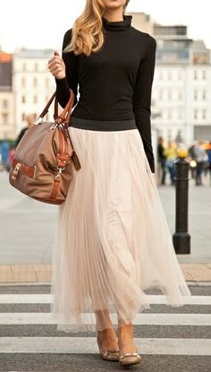 Long tulle skirt that has it's super girlyness neutralized by a modest and quiet black top