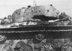 KV-1 showing non-penetrating hits on the turret. The condition of the paint shows extreme combat conditions.