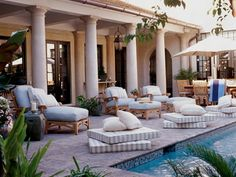 Interiors flow easily into the home's courtyard, where a lap pool and comfortable seating make the area a sanctuary. (Photo: Photo: Jean Allsopp;)