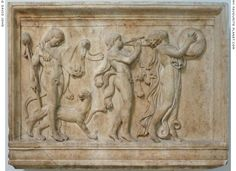 A marble relief with two satyrs and a maenad in a Dionysiac procession at My Favourite Planet