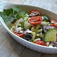 """Replace spaghetti noodles with """"zoodles"""", noodles made from zucchini, in this Greek salad with olive, tomato, and feta cheese."""