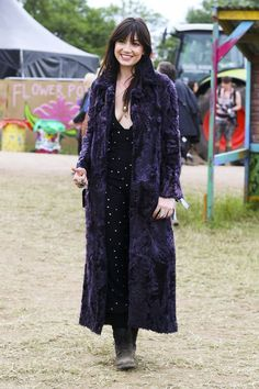 30+ Pics Of Glastonbury's Street-Style Stars #refinery29  http://www.refinery29.com/2015/06/89749/glastonbury-street-style-pictures-2015#slide-1  Model Daisy Lowe keeps cozy in a full-length faux fur.
