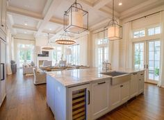 The kitchen pendants are the Gustavian Lantern from Circa Lighting. The chandeliers are Arteriors Geoffrey 12 Light Chandelier