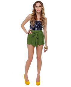 The Lily Picking Green Shorts shimmer like a fairy in the woods. These satiny woven shorts have flared legs that gather into a belted waistline. Green Shorts, Smocking, Short Dresses, Lily, Model, How To Wear, Black, Style, Fashion