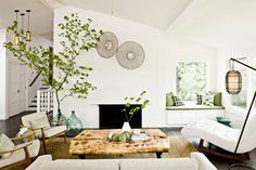 organic modern, well that just sums me up now doesn't it.  LOVE the tree, fireplace, windowseat, Danish furniture, etc