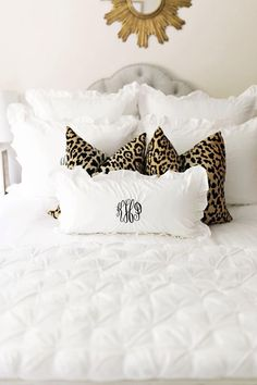 Leopard pillows + white sheets